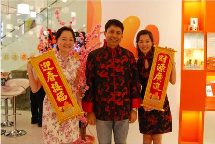 Dr. Kaizad Heerjee (middle), CEO of U Mobile Sdn Bhd donned a Chinese New Year-themed attire to share the joy of Chinese New Year with U Mobile customers. Accompanying Dr. Kaizad were U Mobile staff Sharon Teo (left) and Adriena Lee.