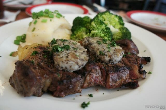 New York Strip with wild mushroom butter sauce